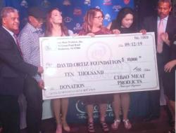 Cibao Meat Prods entrega donacion al Fondo para la Niñez David Ortiz
